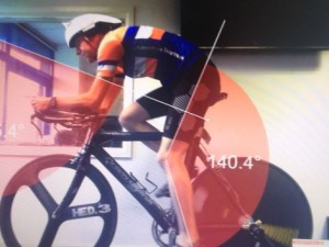 Triathlete training on indoor bike showing optimum angle for legs